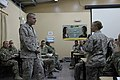 U.S. Marine Corps Sgt. Maj. Bryan B. Battaglia, standing left, the senior enlisted adviser to the Chairman of the Joint Chiefs of Staff, listens to a Service member's question at Forward Operating Base Gamberi 130504-A-CL397-007.jpg