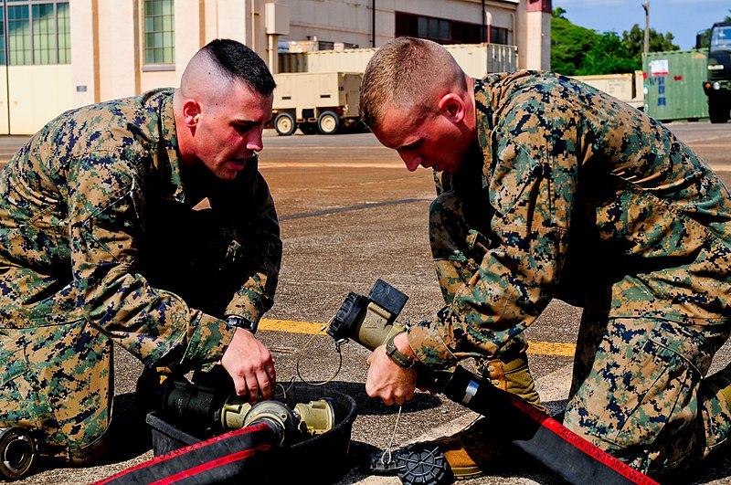 File:U.S. Marine Corps Sgt. Robert Sarvak and Lance Cpl. Nathan Rose, both bulk fuel specialists with the Marine Wing Support Detachment based in Marine Corps Base Hawaii, attach a fuel hose to a Y-junction connector 131118-A-UG106-261.jpg