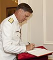 U.S. Navy Adm. Mark E. Ferguson III, the vice chief of naval operations and an Evening Parade guest of honor, signs a guest book during the parade reception at the Home of the Commandants in Washington, D.C 130607-M-KS211-003.jpg