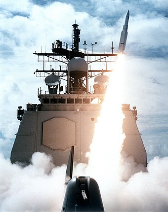 A missile departs the forward launcher of Vincennes during a 1987 exercise. This ship later shot down civilian airliner Iran Air 655. USS Vincennes launching SM-2MR in 1987.jpg