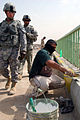 US Army 52958 TAJI, Iraq- Ozark, Ala. native, Lt. Col. Eric Schwegler (left), commander of the 1st Battalion, 82nd Field Artillery Regiment, 1st Brigade Combat Team, 1st Cavalry Division, walks past as a contractor.jpg