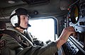 US Navy 021230-N-9851B-225 Aviation Warfare Systems Operator Airman Patrick Frizzelle monitors the position of his SH-60 Seahawk helicopter.jpg