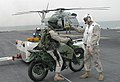 US Navy 030212-N-2379C-010 A member of the 15th Marine Expeditionary Unit (MEU) Special Operations Capable (SOC) waits his turn to onload his motorcycle for a helicopter flight into Kuwait.jpg