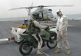 Diesel motorcycle - A USMC M1030M1 motorcycle and rider awaiting a helicopter flight into Kuwait.