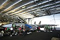 US Navy 030428-N-4308O-006 Sailors assigned to the Swordsman of Fighter Squadron Thirty Two (VF-32) perform maintenance to an F-14 Tomcat in the hangar bay after it had broken the sound barrier during an air power demonstration.jpg