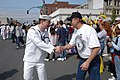 US Navy 030510-N-6477M-173 Vietnam veteran Doug Meek shakes hands with Machinist's Mate 3rd Class James Devaldar assigned to USS Abraham Lincoln (CVN 72) during a ticker-tape parade in honor of all Lincoln Sailors and the.jpg