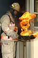 US Navy 030718-N-8218W-035 Deputy Fire Chief David White from Fremont, Calif., demonstrates how dangerous it is to try to move a cooking fire, while taping a fire safety video.jpg