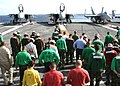 US Navy 030915-N-9907G-501 Crewmembers scour the flight deck during a Foreign Object Damage (FOD) walk down aboard USS Theodore Roosevelt (CVN 71).jpg