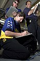 US Navy 040401-N-5862D-134 Car Chief Eddie Buffington and members of the Fitz-Bradshaw racing team sign off checklists and file paperwork for the Navy sponsored ^14 Chevrolet Monte Carlo.jpg