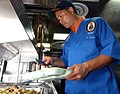 US Navy 040503-N-7391W-063 Celebrity Chef Roy Yamaguchi dishes up lunch during a visit to the Pearl Harbor-based guided missile frigate USS Crommelin (FFG 37).jpg