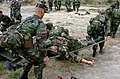 US Navy 040525-N-9712C-001 Members of Naval Mobile Construction Battalion Forty (NMCB-40) carry a wounded victim on a stretcher during a mock mass casualty drill.jpg