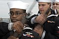 US Navy 040611-N-3642E-010 Honor Guard member Fire Controlman 2nd Class Josue Chevalier, from Bridgeport, Conn., lowers his M-14 rifle after receiving an order.jpg
