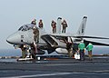 """US Navy 040619-N-2325K-035 Crew members clean an F-14B Tomcat assigned to the """"Red Rippers"""" of Fighter Squadron One One (VF-11) on the flight deck aboard USS George Washington (CVN 73).jpg"""