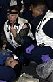 US Navy 050113-N-5549O-088 Senior Medical Officer, Cmdr. John Burgess of Goldsboro, N.C., trains crew members on first aid procedures during a mass casualty drill.jpg