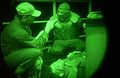 US Navy 050531-N-8604L-093 Hospital Corpsman 2nd Class Chris Mathena conducts emergency medical training on a Sailor with simulated facial injuries during a general quarters drill.jpg