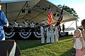 US Navy 050702-N-4781D-032 Sailors assigned to the amphibious assault ship USS Iwo Jima (LHD 7) serve as the ceremonial color guard for a symphony in an open venue park.jpg