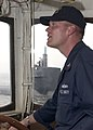 US Navy 060621-N-5686B-001 Boatswain's Mate 1st Class Adam Melancon maneuvers the tugboat USS Opelika (YTB 798) as it approaches the Los Angeles-class fast attack submarine USS Buffalo (SSN 715).jpg