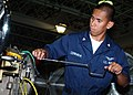 US Navy 060817-N-1810F-023 Aviation Machinist Mate 3rd Class Marlo Cerado disassembles a SH-60B Seahawk Helicopter engine, for inspection and cleaning.jpg
