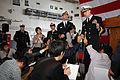 US Navy 061106-N-1332Y-252 USS Kitty Hawk (CV 63) Commanding Officer, Capt. Ed McNamee, addresses local Japanese media prior to arriving in Sasebo for a port visit.jpg