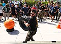 US Navy 061118-N-6775N-217 Navy Diver 2nd Class Steve Schilz lifts a 165 pound forklift tire on to the back of a truck as part of the Mobile Diving and Salvage Unit One (MDSU-1) first Strongman Contest.jpg