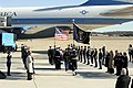 US Navy 070102-F-0194C-114 Members of the Ceremonial Honor Guard carry the casket of former President Gerald R. Ford, 38th President of the United States as Andrews Air Force Base, Md.jpg