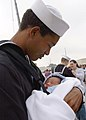 US Navy 070309-N-8544C-022 Seaman John Neal embraces his son for the first time at the homecoming ceremony for guided missile frigate USS Taylor (FFG 50).jpg