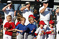 US Navy 070421-N-7163S-002 Little League players from the Mount Washington Youth Baseball-Softball Association and Sailors from Navy Recruiting District salute the flag during a ceremony to dedicate the seven- and eight-year-ol.jpg