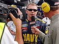 US Navy 070504-N-5345W-055 NASCAR Busch Series driver Shane Huffman, driver of the U.S. Navy ^88 Chevy Monte Carlo, answers questions from Speed Channel's Dick Berggren after qualifying a career-high 3rd for the Circuit City 25.jpg