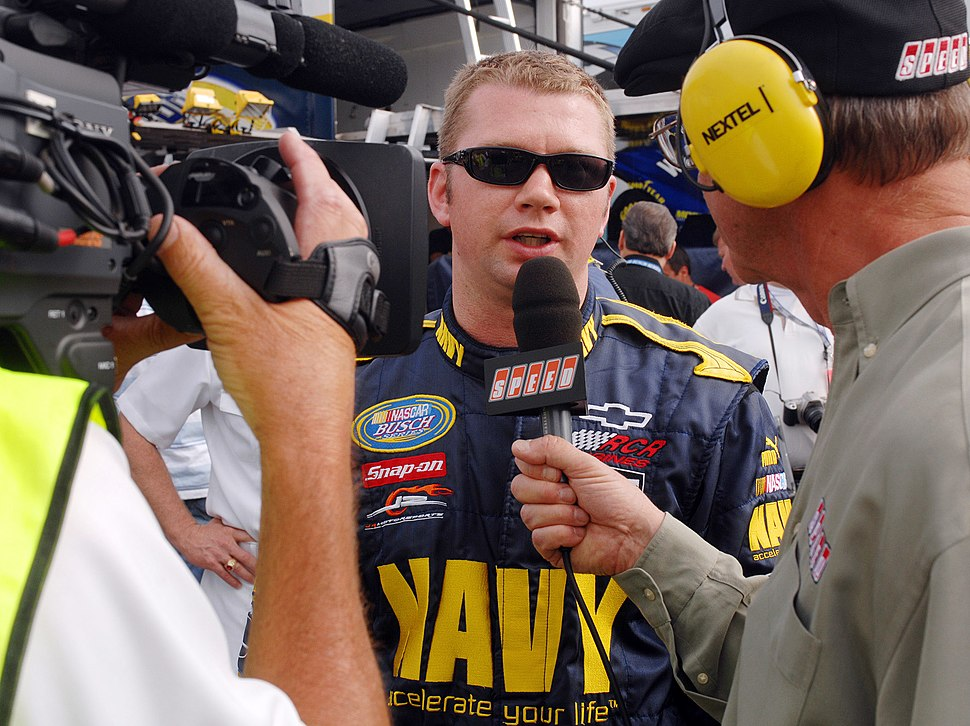 US Navy 070504-N-5345W-055 NASCAR Busch Series driver Shane Huffman, driver of the U.S. Navy ^88 Chevy Monte Carlo, answers questions from Speed Channel's Dick Berggren after qualifying a career-high 3rd for the Circuit City 25