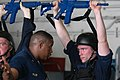 US Navy 070808-N-5387K-002 Anti-terrorism instructor Chief Master-at-Arms Tyjuan Frazier instructs Shipboard Reaction Force (SBRF) trainee Aviation Structural Mechanic Airman Charles Moran.jpg
