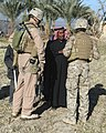US Navy 071229-M-4746J-031 Marines assigned to I Co., 3rd Battalion, 3rd Marine Regiment greet a local shiek in Zaidon, Iraq during a mission to gather information, patrol area neighborhoods and interact with the residents, and.jpg