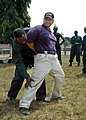 US Navy 080212-N-0577G-015 Africa Partnership Station (APS) instructor Chief Master-At-Arms Felix Rivera of Coral Springs, Fla. is handcuffed and checked for weapons by a student from the Ghanaian Port Authority during a lesson.jpg