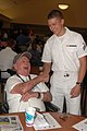 US Navy 080723-N-7975R-001 Culinary Specialist Seaman Apprentice David Worthington, assigned to the Los Angeles-class fast-attack submarine USS Annapolis (SSN 760), meets Navy veteran, Electrician's Mate 3rd Class Gil Fishbec.jpg