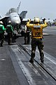 US Navy 080828-N-3659B-038 An aviation boatswain's mate (handling) gives the hand signal for the pilot of an F-A-18C Hornet assigned VFA-25 to taxi forward onto catapult 2 on the flight deck of USS Ronald Reagan (CVN 76).jpg
