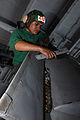 US Navy 081007-N-3610L-082 Aviation Structural Mechanic 3rd Class Omar Yacsavilca removes a panel from the wing of an F-A-18C Hornet.jpg