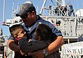 US Navy 090417-N-0649J-005 Culinary Specialist 1st Class Mauricio Sanchez, from San Antonio, Calif. hugs his sons after the mine countermeasure ship USS Warrior (MCM 10) arrives at its new homeport in San Diego.jpg