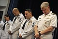 US Navy 090529-N-8273J-154 Chief of Naval Operations (CNO) Adm. Gary Roughead, and the finalists of the CNO Shore Activities Sailor of the Year, bow their heads during the benediction of the SOY announcement ceremony at the Pen.jpg