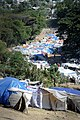 US Navy 100128-N-8828S-119 The Petionville Country Club in Port-au-Prince, Haiti is being used as a field hospital, food distribution location and as a tent city to house 50,000 earthquake survivors.jpg