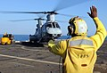 US Navy 100302-N-5538K-065 Aviation Support Equipment Technician Airman Tione M. Williams directs the loading of equipment into a CH-46E Sea Knight on the flight deck of the forward-deployed amphibious transport dock USS Denver.jpg