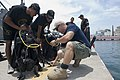 US Navy 100706-N-1134L-061 Navy Diver 1st Class Shawn Cooley, assigned to Company 2-6 of Mobile Diving and Salvage Unit (MDSU) 2, sets up dive gear with Mexican navy divers.jpg