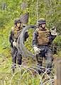 US Navy 100819-N-4440L-196 Cmdr. Richard Hayes III, commanding officer of Naval Mobile Construction Battalion (NMCB) 74, and Ensign James Schneider move concertina wire into position to set up a defensive line.jpg