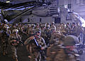 US Navy 100919-N-9950J-187 Marines assigned to the 31st Marine Expeditionary Unit (31st MEU) prepare for a simulated air raid aboard the forward-de.jpg
