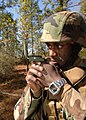 US Navy 101104-N-8816D-002 Chief Utilitiesman Michael Gibson, assigned to Naval Mobile Construction Battalion (NMCB) 133, shoots a heading with a m.jpg
