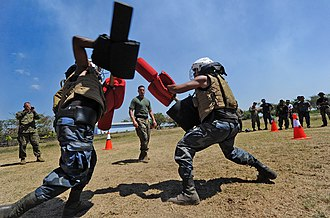 Pugil stick - Nicaraguan soldiers training using pugil sticks and protective gear