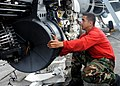 US Navy 110917-N-ZZ999-028 Aviation Ordnanceman 2nd Class Jason Ortiz, from Brooklyn, N.Y., installs an M61A1 machine gun on an F-A-18C Hornet.jpg