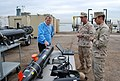 US Navy 111111-N-WE331-001 Congressman Mike McIntyre receives a capabilities brief from Sailors attached to Explosive Ordnance Disposal Mobile Unit.jpg