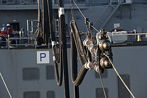 US Navy 120129-N-PB383-280 A double-probed fuel hose from the Military Sealift Command dry cargo and ammunition ship USNS Charles Drew (T-AKE 10) a.jpg
