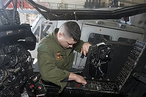 US Navy 120130-N-QM601-103 A Sailor troubleshoots communication and radio hardware on an AH-1A Cobra helicopter in the hangar bay aboard the amphib.jpg