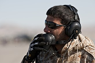 United Arab Emirates Air Force - UAEAF crew chief communicating during an engine test at Nellis Air Force Base during Red Flag 11-2 on February 2, 2011.