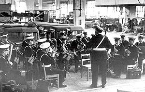 The Helsinki Police Band performing in a ceremony of Vanajan Autotehdas factory in 1957. The band is under the baton of Georg Malmstén.
